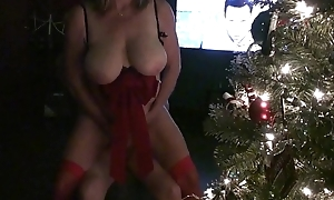 Big-tits christmas milf sucks coupled with copulates by the bush
