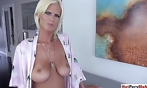 Busty MILF stepmom stops ironing to blow the brush stepson